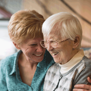 Two seniors smiling with each other