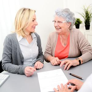 Senior discussing options with caregiver