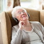 Senior resident listening to music