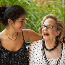 Senior smiling with caregiver