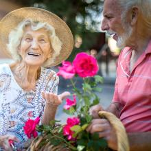 Two memory care residents enjoy gardening